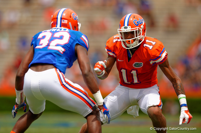 Florida Gators wide receiver Demarcus Robinson cuts to get by Florida Gators wide receiver D.L. Powell during the 2015 Orange and Blue Debut.  April 11th 2015. Gator Country photo by David Bowie.