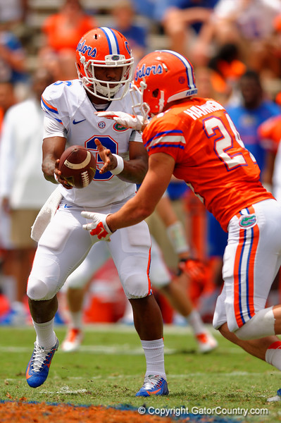 Florida Gators quarterback Treon Harris turns and hands the ball off to Florida Gators wide receiver Case Harrison during the 2015 Orange and Blue Debut.  April 11th 2015. Gator Country photo by David Bowie.