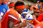 Florida Gators safety Duke Dawson signs autographs during the 2015 Orange and Blue Debut.  April 11th 2015. Gator Country photo by David Bowie.