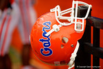 A Florida Gators helmet hangs on the fence during the 2015 Orange and Blue Debut.  April 11th 2015. Gator Country photo by David Bowie.