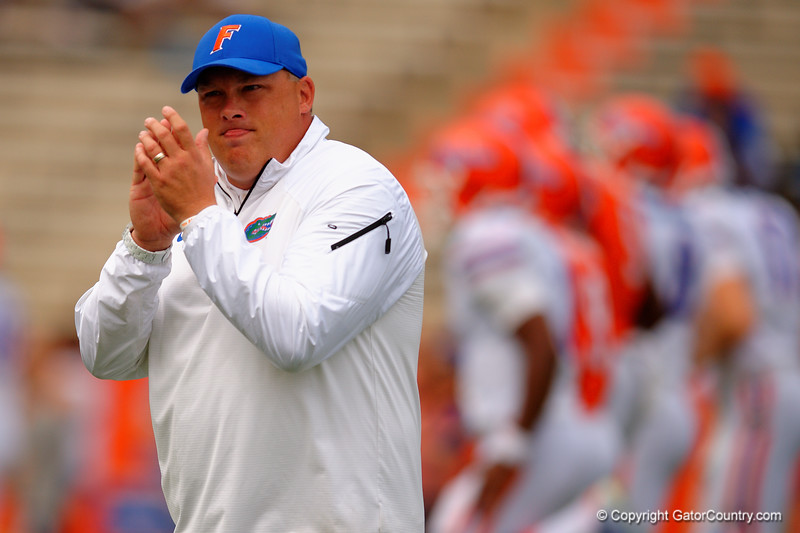 Florida Gators defensive coordinator Geoff Collins urges on his players as the stretch out prior to kickoff during the 2015 Orange and Blue Debut.  April 11th 2015. Gator Country photo by David Bowie.