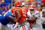 Florida Gators quarterback Treon Harris scrambles behind Florida Gators offensive line Antonio Riles during the 2015 Orange and Blue Debut.  April 11th 2015. Gator Country photo by David Bowie.