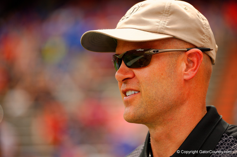 Florida Gators Hall of Fame quarterback Danny Wuerffel smiles as he watches on during the 2015 Orange and Blue Debut.  April 11th 2015. Gator Country photo by David Bowie.