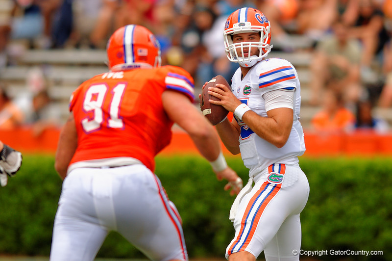 Florida Gators quarterback Jacob Guy looks downfield as Florida Gators defensive lineman Joey Ivie rushes in during the 2015 Orange and Blue Debut.  April 11th 2015. Gator Country photo by David Bowie.