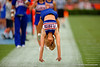 A Florida Gators cheerleader backflips down the sideline during the 2015 Orange and Blue Debut.  April 11th 2015. Gator Country photo by David Bowie.
