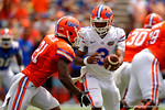 Florida Gators quarterback Treon Harris turns and hands the ball of to Florida Gators running back Kelvin Taylor during the 2015 Orange and Blue Debut.  April 11th 2015. Gator Country photo by David Bowie.