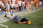 A Tennessee Volunteers coach lays on the turf in disbelief that they lost as the Gators come from behind late in the fourth quarter at home to beat the Tennessee Volunteers 28-27.  September 26th, 2015. Gator Country photo by David Bowie.