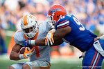 Tennessee Volunteers running back Jalen Hurd is tackled by Florida Gators defensive lineman Jonathan Bullard as the Gators come from behind late in the fourth quarter at home to beat the Tennessee Volunteers 28-27.  September 26th, 2015. Gator Country photo by David Bowie.