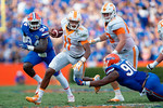 Tennessee Volunteers quarterback Joshua Dobbs breaks through a diving tackle by Florida Gators defensive lineman Jonathan Bullard in the first half as the Gators come from behind late in the fourth quarter at home to beat the Tennessee Volunteers 28-27.  September 26th, 2015. Gator Country photo by David Bowie.