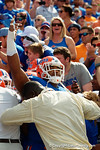 Florida Gators defensive lineman Caleb Brantley is held back by former Gator Alex Brown as the Gators come from behind late in the fourth quarter at home to beat the Tennessee Volunteers 28-27.  September 26th, 2015. Gator Country photo by David Bowie.
