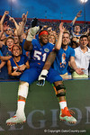 Florida Gators offensive line Antonio Riles jumps into the crowd in celebration after the win as the Gators come from behind late in the fourth quarter at home to beat the Tennessee Volunteers 28-27.  September 26th, 2015. Gator Country photo by David Bowie.