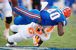 Florida Gators linebacker Jarrad Davis with a huge hit on Vols running back Alvin Kamara in the second half as the Gators come from behind late in the fourth quarter at home to beat the Tennessee Volunteers 28-27.  September 26th, 2015. Gator Country photo by David Bowie.