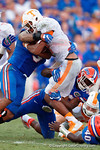 Florida Gators defensive back Keanu Neal and Florida Gators linebacker Antonio Morrison combine for a tackle in the second half as the Gators come from behind late in the fourth quarter at home to beat the Tennessee Volunteers 28-27.  September 26th, 2015. Gator Country photo by David Bowie.