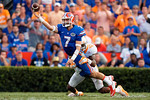 Florida Gators quarterback Will Grier throws downfield while being tackled during the second half as the Gators come from behind late in the fourth quarter at home to beat the Tennessee Volunteers 28-27.  September 26th, 2015. Gator Country photo by David Bowie.