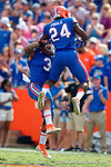 Florida Gators defensive back Brian Poole and Florida Gators quarterback Treon Harris celebrate as the Gators come from behind late in the fourth quarter at home to beat the Tennessee Volunteers 28-27.  September 26th, 2015. Gator Country photo by David Bowie.