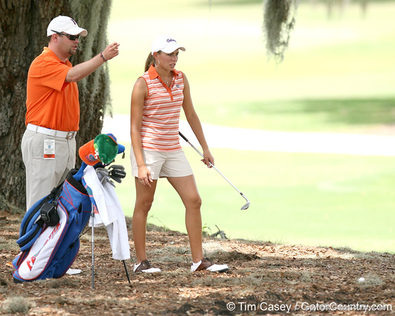 Jay Goble gives advice to Lauren Uzelatz on the 9th hole during the first round of the NCAA Women's Golf East Regional on Thursday, May 7, 2009 at the Mark Bostick Golf Course in Gainesville, Fla. / Gator Country photo by Tim Casey