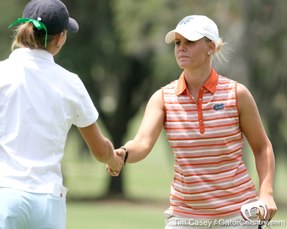 Florida sophomore Jessica Yadloczky shakes hands with a Tulane golfer the first round of the NCAA Women's Golf East Regional on Thursday, May 7, 2009 at the Mark Bostick Golf Course in Gainesville, Fla. / Gator Country photo by Tim Casey