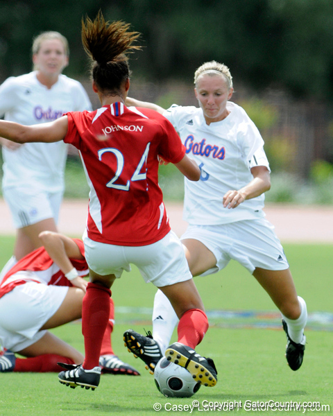photo by Casey Brooke Lawson<br /> <br /> Florida junior midfielder Jessica Eicken challenges for the ball during the Gators' 2-1 win against the Kansas Jayhawks on Sunday, September 21, 2008 at James G. Pressly Stadium in Gainesville, Fla.