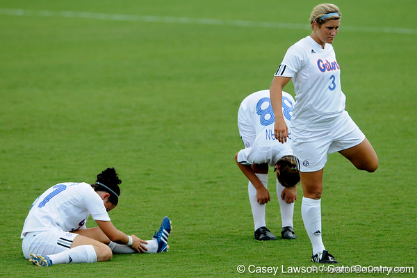 photo by Casey Brooke Lawson<br /> <br /> Florida freshman defender Lindsay Williams and Sarah Chapman stretch during the Gators' 2-1 win against the Kansas Jayhawks on Sunday, September 21, 2008 at James G. Pressly Stadium in Gainesville, Fla.