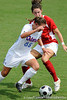 photo by Casey Brooke Lawson<br /> <br /> Florida freshman midfielder/defender Sarah Chapman moves around a defender during the Gators' 2-1 win against the Kansas Jayhawks on Sunday, September 21, 2008 at James G. Pressly Stadium in Gainesville, Fla.
