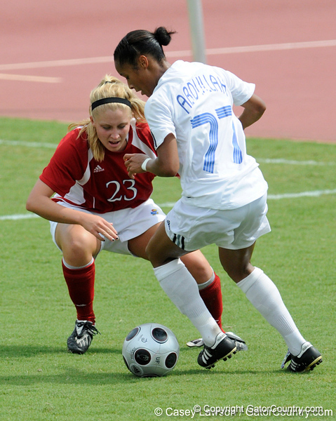 photo by Casey Brooke Lawson<br /> <br /> Florida senior midfielder/forward Ameera Abdullah moves around a defender during the Gators' 2-1 win against the Kansas Jayhawks on Sunday, September 21, 2008 at James G. Pressly Stadium in Gainesville, Fla.