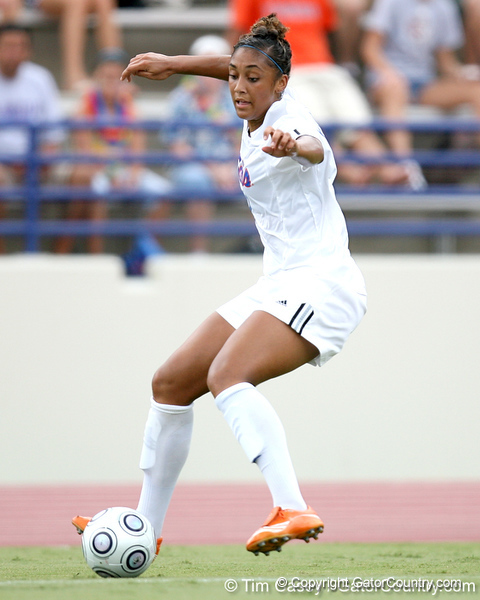 Florida senior midfielder Ashlee Elliott makes a move past a defender, suffering a torn ACL in her right knee, during the first half of the Gators' 2-1 win against the South Florida Bulls on Sunday, August 30, 2009 at James G. Pressly Stadium in Gainesville, Fla / Gator Country photo by Tim Casey