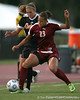 Florida midfielder Lindsay Thompson fights for position with Florida State defender Toni Pressley during the Gators' 1-0 overtime loss to the Seminoles on Friday, September 18, 2009 at James G. Pressly Stadium in Gainesville, Fla. / Gator Country photo by Tim Casey