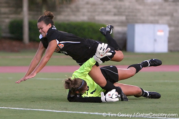 Florida sophomore midfielder Tahnai Annis collides with FIU goalkeeper Melanie Raimo during the Gators' 3-0 win against the Golden Panthers on Friday, August 28, 2009 at James G. Pressly Stadium in Gainesville, Fla / Gator Country photo by Tim Casey