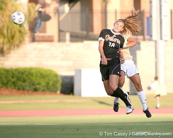 Florida sophomore midfielder/forward Lindsay Thompson heads the ball forward during the Gators' 3-0 win against the Florida International Golden Panthers on Friday, August 28, 2009 at James G. Pressly Stadium in Gainesville, Fla / Gator Country photo by Tim Casey