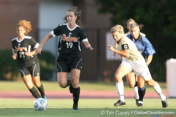 Florida senior defender Caitlin Howard runs with the ball during the Gators' 3-0 win against the Florida International Golden Panthers on Friday, August 28, 2009 at James G. Pressly Stadium in Gainesville, Fla / Gator Country photo by Tim Casey