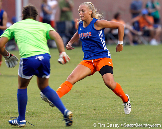 Florida redshirt-junior midfielder McKenzie Barney follows through on a shot during the Gators' Orange & Blue Scrimmage on Friday, August 12, 2011 at the UF Lacrosse/Soccer Facility in Gainesville, Fla. / Gator Country photo by Tim Casey