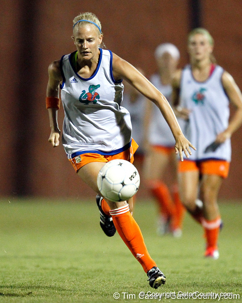 Florida redshirt-junior defender Kathryn Williamson runs with the ball during the Gators' Orange & Blue Scrimmage on Friday, August 12, 2011 at the UF Lacrosse/Soccer Facility in Gainesville, Fla. / Gator Country photo by Tim Casey