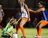 Florida freshman goalkeeper Taylor Burke dives on the ball as redshirt-junior defender Kathryn Williamson looks for a rebound during the Gators' Orange & Blue Scrimmage on Friday, August 12, 2011 at the UF Lacrosse/Soccer Facility in Gainesville, Fla. / Gator Country photo by Tim Casey