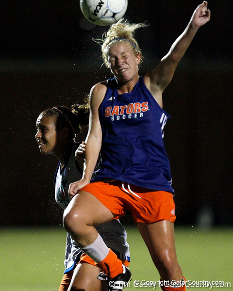 Florida freshman forward Tessa Andujar heads the ball during the Gators' Orange & Blue Scrimmage on Friday, August 12, 2011 at the UF Lacrosse/Soccer Facility in Gainesville, Fla. / Gator Country photo by Tim Casey