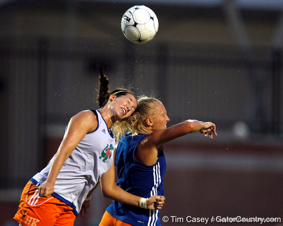 Florida junior midfielder Holly King and redshirt-junior midfielder McKenzie Barney battle for the ball during the Gators' Orange & Blue Scrimmage on Friday, August 12, 2011 at the UF Lacrosse/Soccer Facility in Gainesville, Fla. / Gator Country photo by Tim Casey