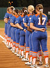 Gators assemble down the First Base line for the playing of the National Anthem