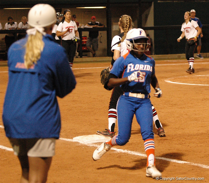 Michelle Moultrie safely reaches 1st Base after her bunt base hit, without the UGA attempting a throw