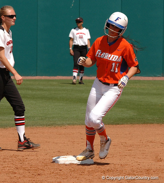 Ensley Gammel touches Second aftr she hit the 3rd Homerun