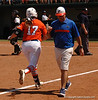 After a Fist-Bump from Coach Walton, Lauren Haeger heads Home