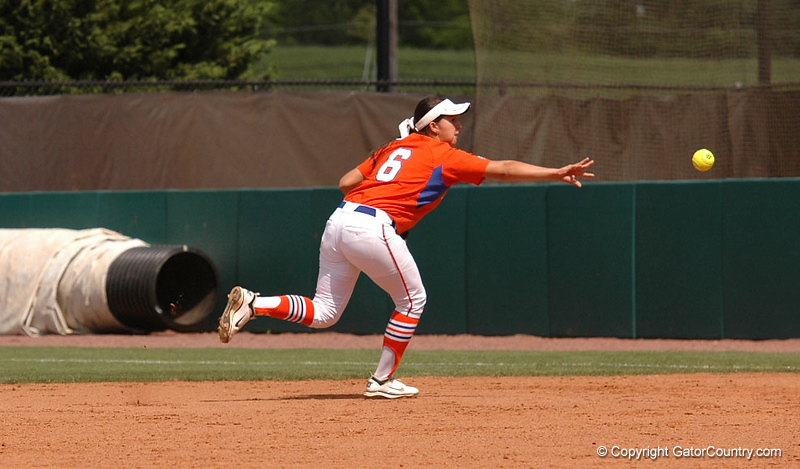 Katie Medina flips the ball to First Base for an out in the 6th Inning