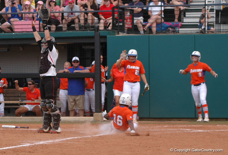 Michelle Moultrie slides safely across Home with the Gators 6th run