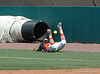 Katie Medina's diving attempt to catch a foul ball just falls short