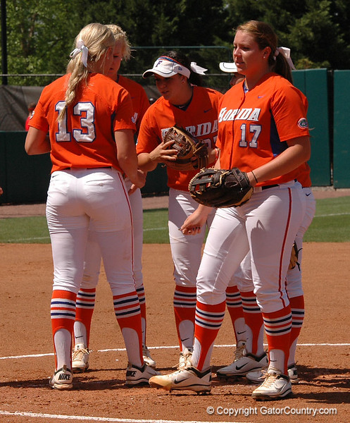 Gator Infielders meet in the circle before the 3rd Inning