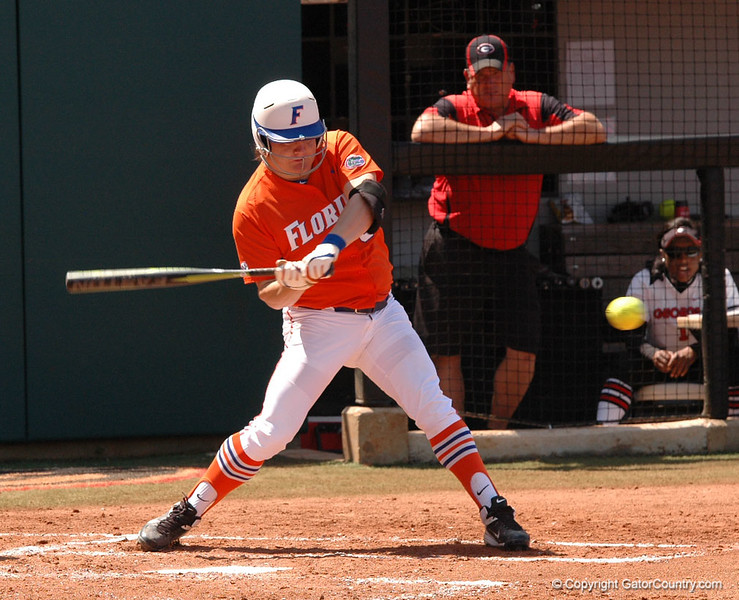 Bailey Castro takes a strong swing in her first at bat