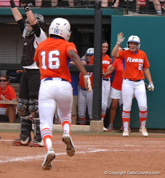 Michelle Moultrie scores from 2B on Lauren Haeger's base hit
