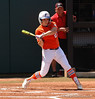 Cheyenne Coyle swings for a base hit