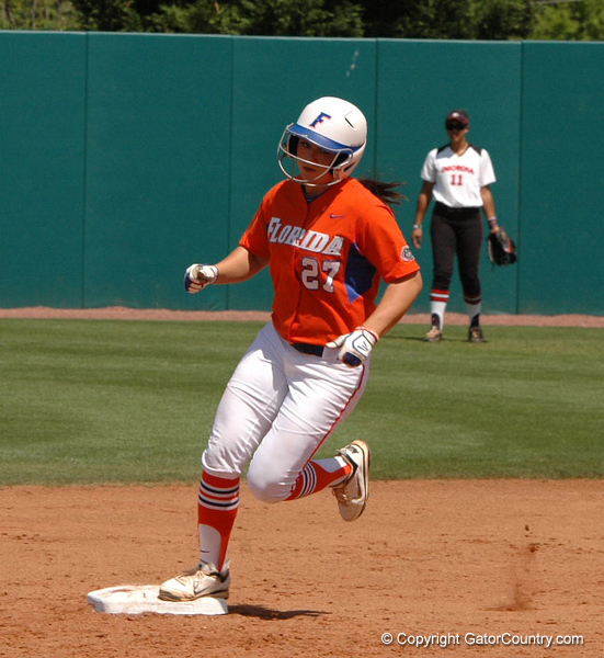 Cheyenne Coyle in her homerun trot, rounds 2nd Base, headed for Home
