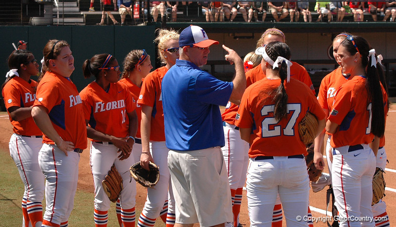 Gator Head Coach Tim Walton gives his team final instructions at the start of Game 3 against UGA