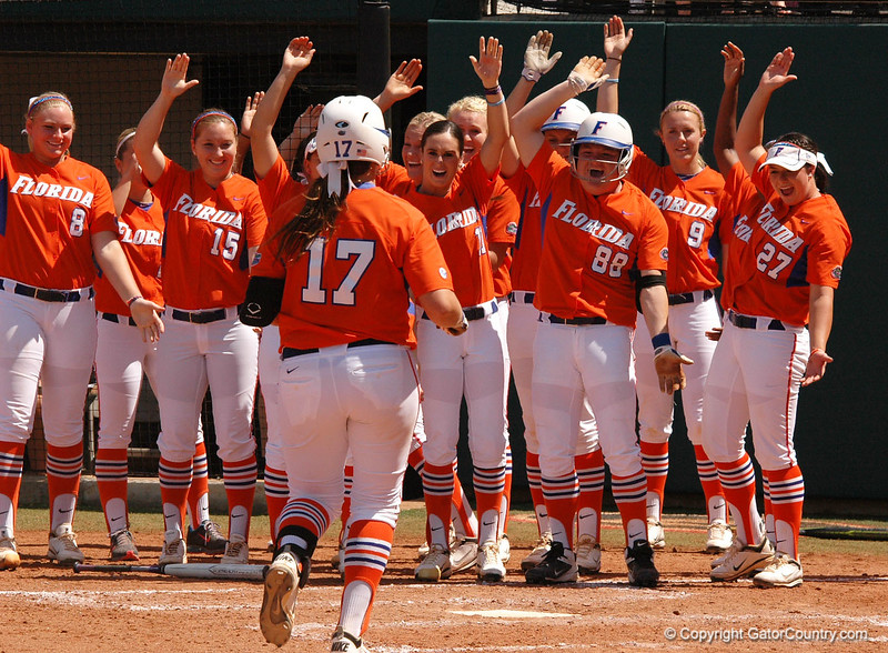 """For the second time in as many hitters, the Gator team congratulates Lauren Haeger with the <br /> """"Homerun Chomp"""""""