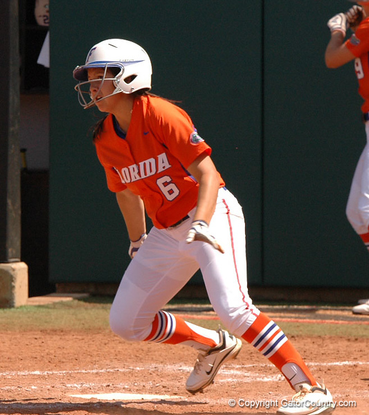 Seeing her drive into the Left Center gap, Katie Medina heads for 1st Base